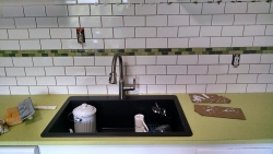 This shows the new sink and how it contrasts well with the new tile and countertop.